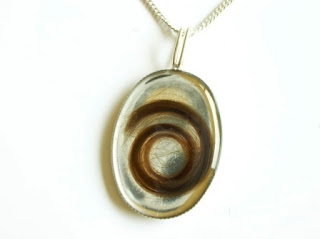Silver pendant for child's first hair