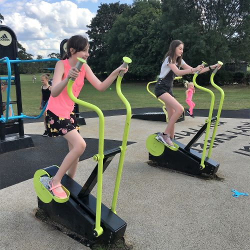 stephs two girls on exercise equipment in park
