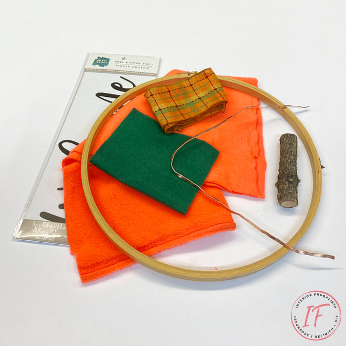 A simple easy peasy embroidery hoop pumpkin wreath tutorial for budget fall decorating with thrift finds, fabric scraps and ribbon you have on hand.
