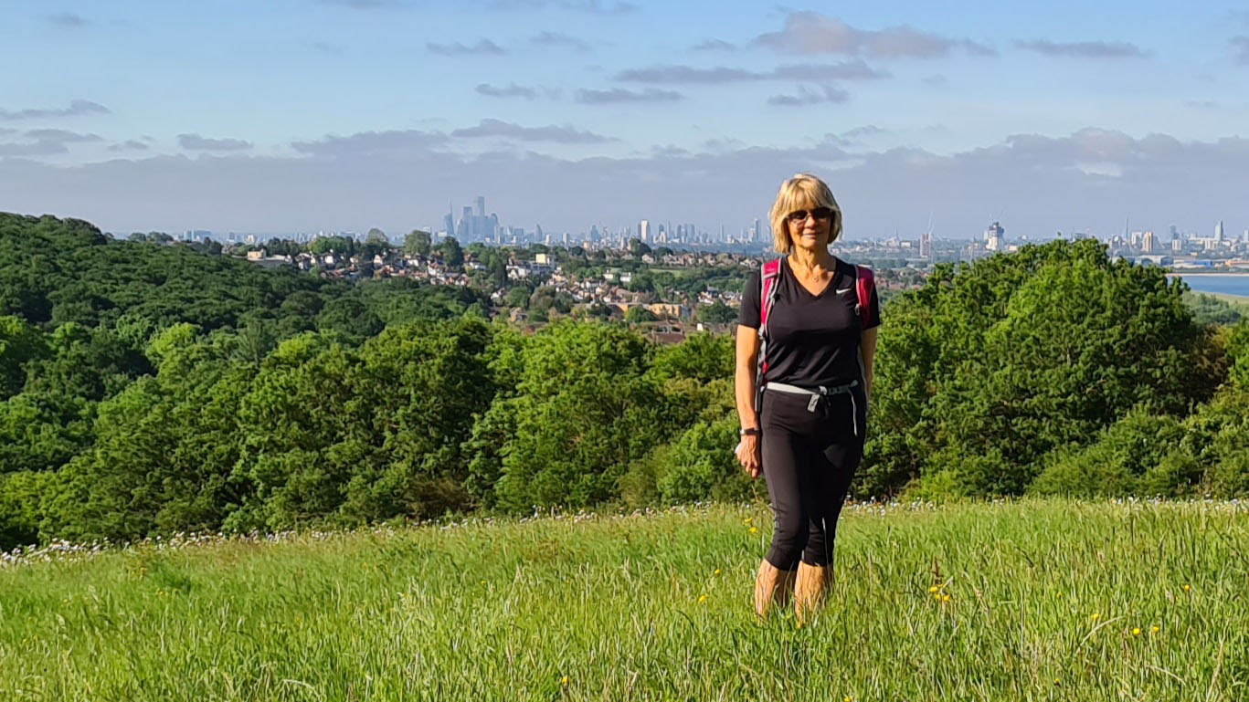 One of the highest points of London at Yates Meadow, Epping Forest, with views of the City behind blogger Gail Hanlon from Is This Mutton?