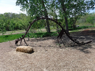 a metal frame of a stegosaurus in the childrens garden in Lauritzen gardens