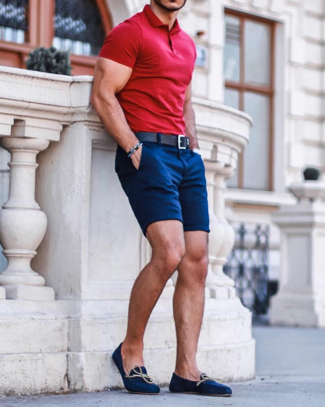 A man in red polo shirt and blue shorts.
