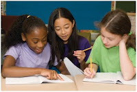 NAMC montessori classroom teaching civics girls writing