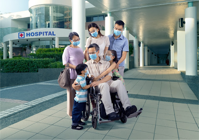 Family picture outside the hospital