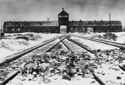 Train tracks going through the Auschwitz-Birkenau gate house.