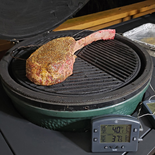 Cooking set up for a tomahawk ribeye steak on the Big Green Egg kamado grill