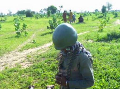 cameroonian soldier pays final respect dead colleague