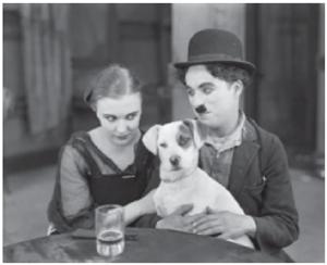 Edna Purviance e Charlie Chaplin em cena do filme Vida de Cachorro