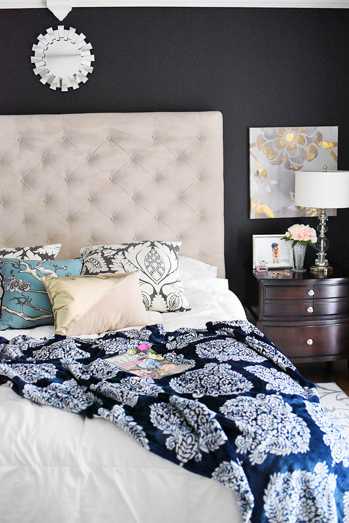 A master bedroom gets a modern farmhouse touch with the addition of some navy, white and damask bedding, curtains and decor. A simple room refresh.
