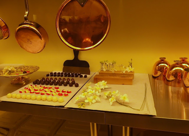 Petit Fours and sugared orchid preparation