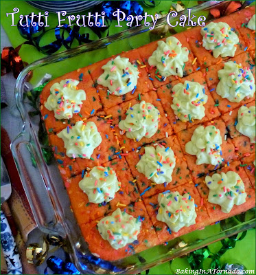 Tutti Frutti Party Cake, a fun colorful cake with hints of lemon, strawberry, orange and key lime, perfect for any occasion. | Recipe developed by www.BakingInATornado.com | #recipe #dessert