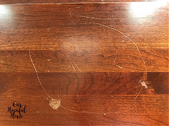scratched mahogany table top
