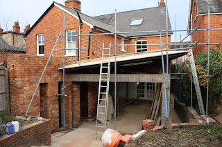 Building site for kitchen extension: putting in the roof
