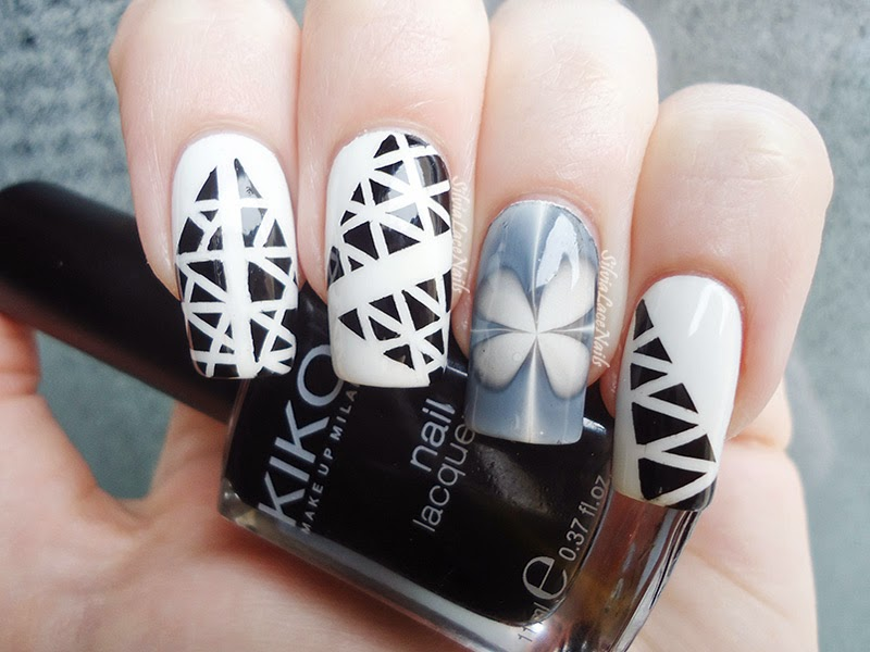 Black&White nail art: triangles and water marble