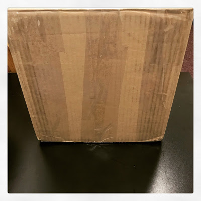 a cardboard box with a lot of packing tape