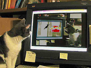 Spackle Puss (the cat) 36 (Watching Herself Watching a Hummingbird 2007)