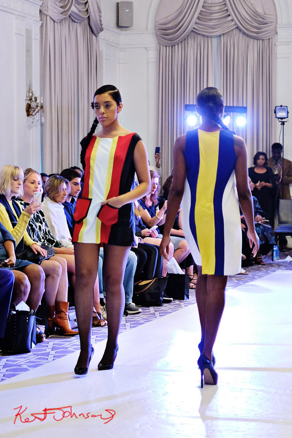 Two models in bright striped colour 60's era inspired dresses. André Bryson - Guerrilla - NYFW. Photographed for Street Fashion Sydney by Kent Johnson.