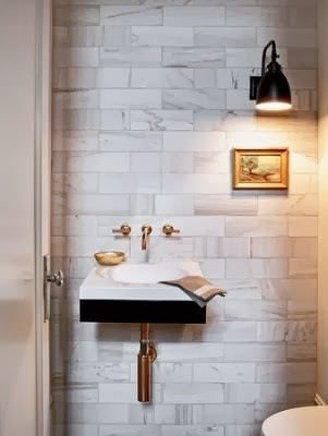 marble walls with brass fixtures