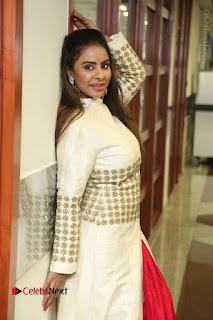 Telugu Actress Sri Reddy Mallidi Stills in White Beautiful Dress at Marriage Needs Bridal Fashion Week 2017 Logo Launch  0018.JPG