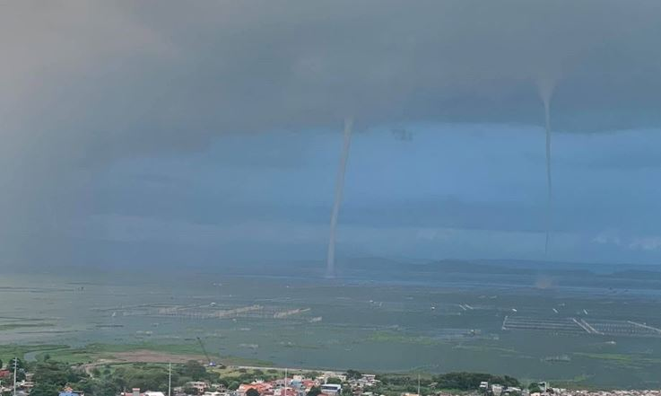 Several waterspouts form before nightfall over Laguna de Bay