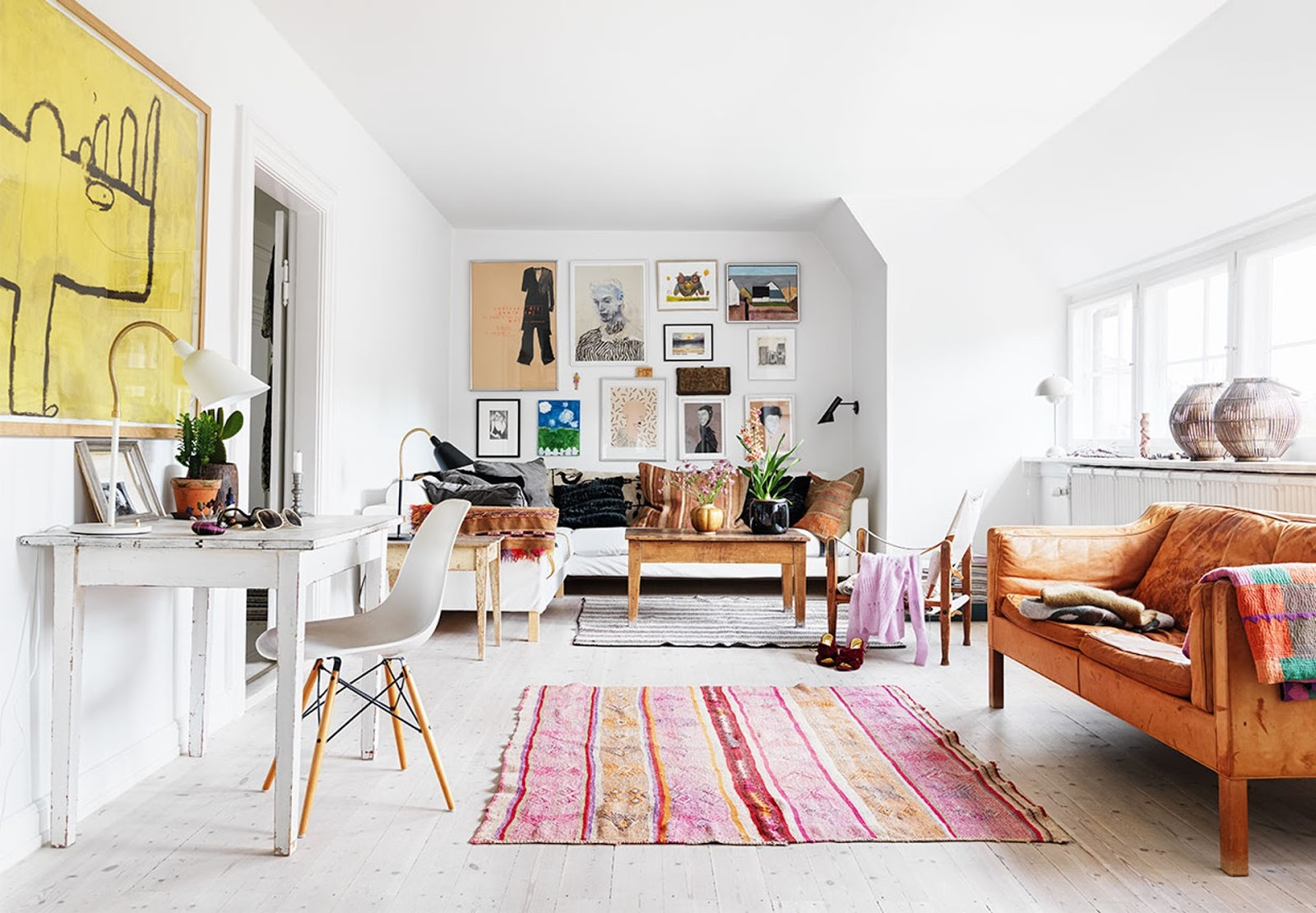 scandinavian interior with colorful rugs, oriental bohemian style, eames chairs, art, vintage furniture