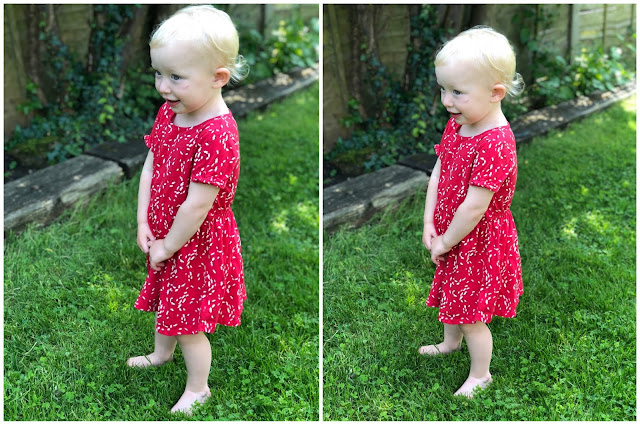 A toddler standing on grass in a red dress taken by the iPhone 8 Plus and iPhone X