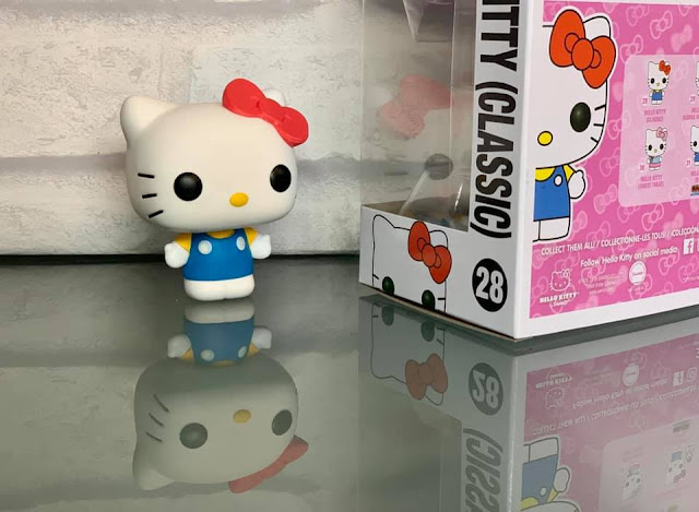 Hello Kitty Classic Funko Pop! Classic figure in blue dress with red bow