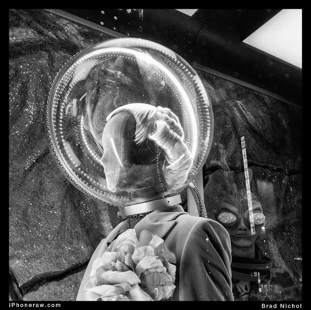 Window display in Ginza, with aliens, monochrome, alien in glass bubble.