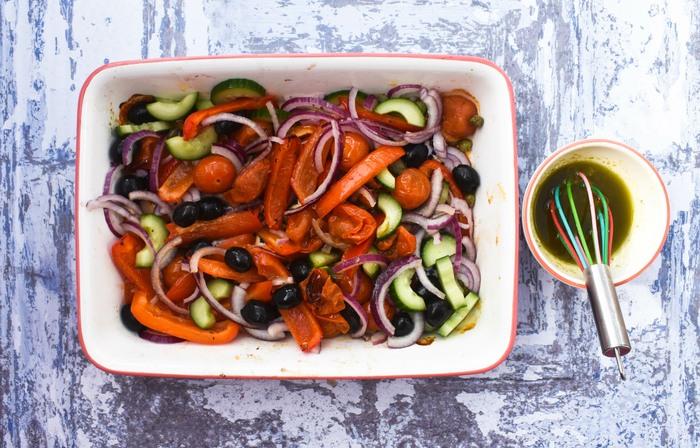 roast vegetable salad mixed in an ovenproof dish