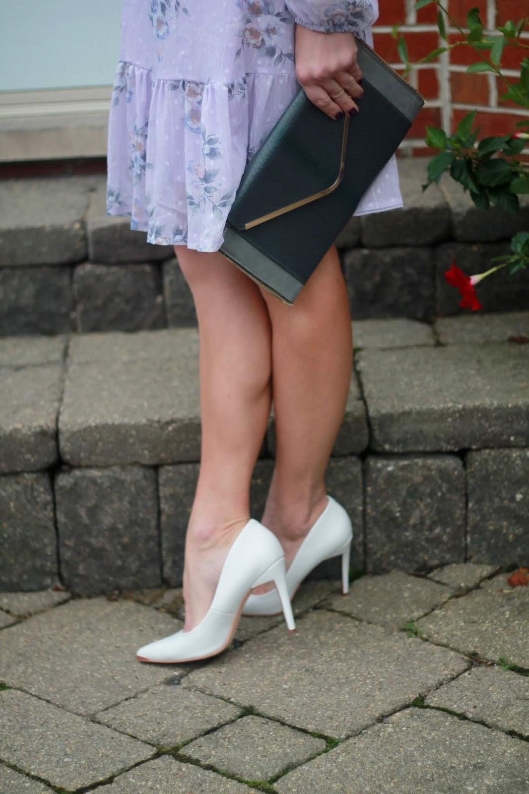 lavender floral dress, white heels, grey envelope clutch