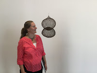 Photo taken by Kurt Keller of Traci Van Wagoner at David Zwirner Gallery with Ruth Asawa sculpture