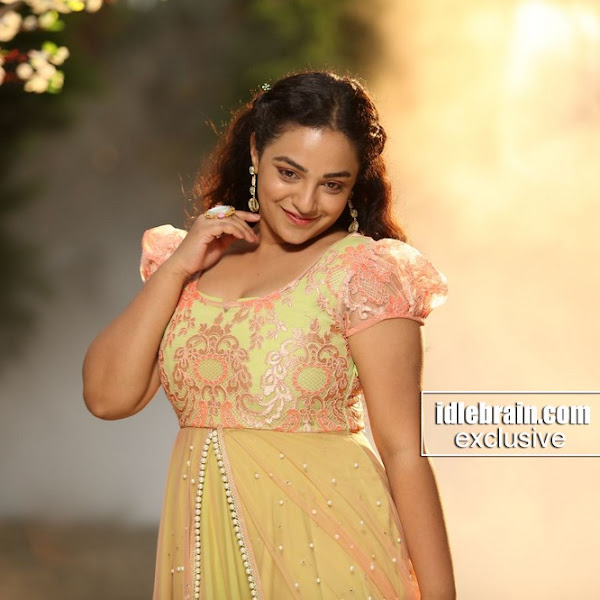 Nithya Menon latest photos from Mudinja Ivana Pudi aka Kotigobba 2