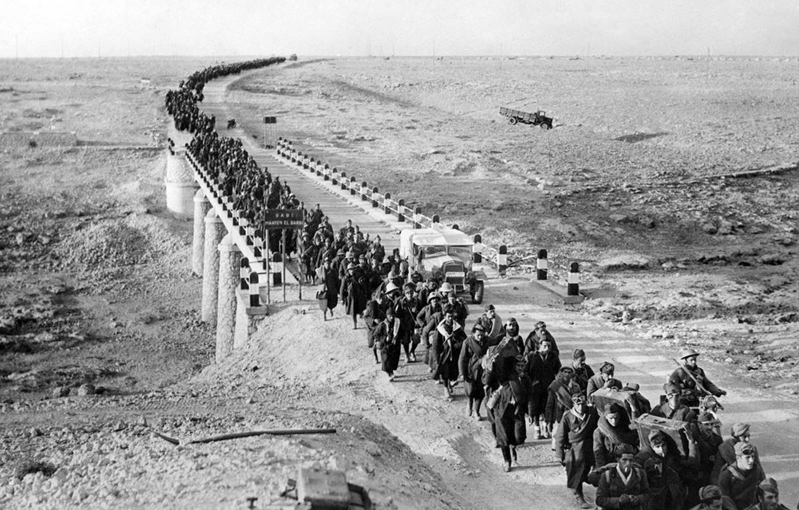 Bardia, a fortified Libyan seaport, was captured by British forces, with more than 38,000 Italian prisoners, including four generals, and vast quantities of war material. An endless stream of Italian prisoners leaves Bardia, on February 5, 1941, after the Australians had taken possession.
