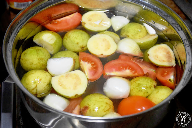 guavas, tomatoes, onion in water