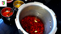 image of adding green chili and cloves in soaked rajma