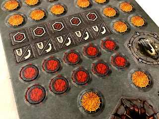 Some of the tokens from Warhammer Underworlds: Nightvault