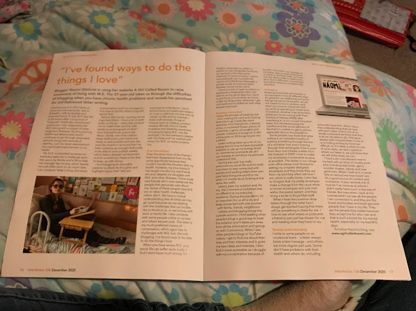 """An open magazine article. The heading is """"I've found new ways to do the things I love"""". The main body of text is unreadable. There is a large photograph of a caucasian young woman with auburn hair in a braid wearing dark glass sat up in bed with a bed table in front of her with her laptop on the bed table. There is also a smaller picture od a laptop with my blog's webpage superimposed on the screen. Behind her is a notice board with colourful item pinned to it."""
