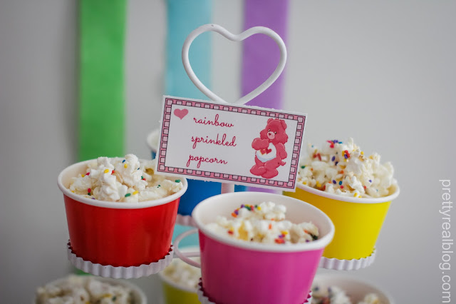 Cups of confetti popcorn for a care bears party