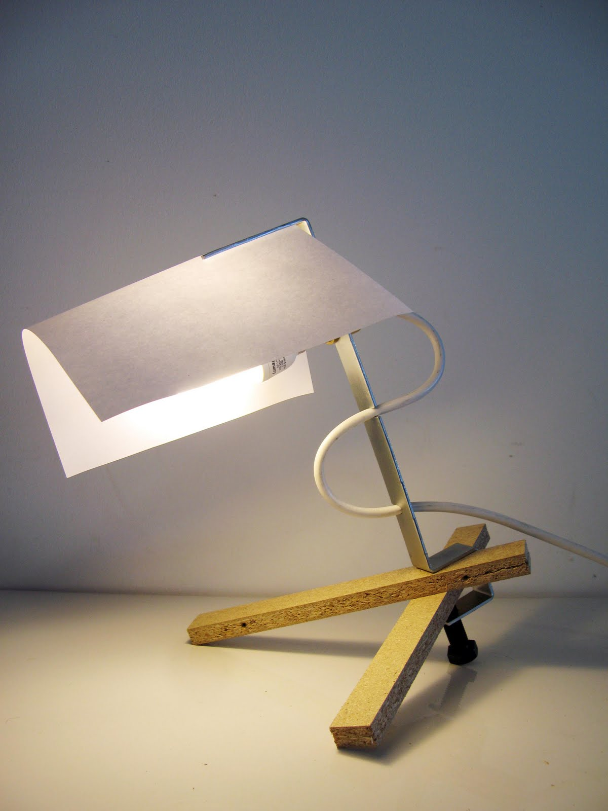 Bracket Clamped Onto Off Cut Wood To Make A Desk Lamp
