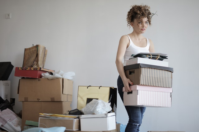 woman decluttering home