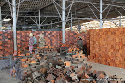 women hauling bricks