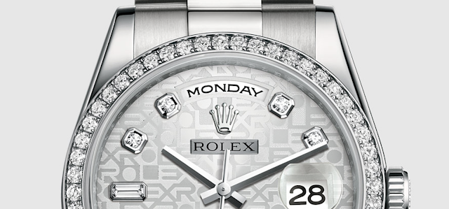 close up photo of platinum diamond rolex day-date