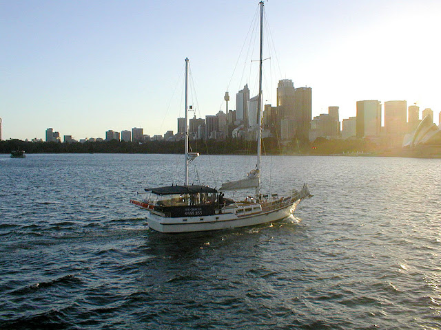 Boat on Sydney Harbour. Australia. Photographed by Susan Walter. Tour the Loire Valley with a classic car and a private guide.
