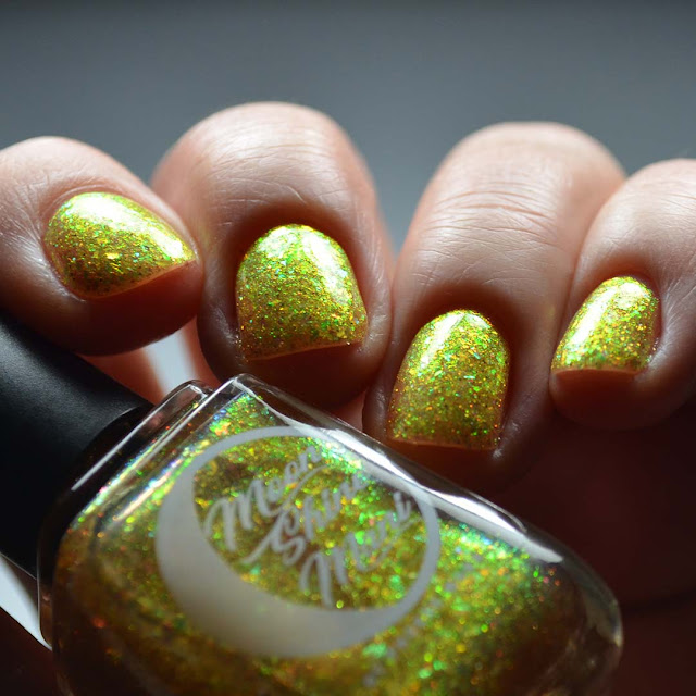gold flakie nail polish low light swatch