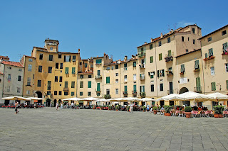 The oval Piazza Antifeatro is a point of interest in the Tuscan city of Lucca