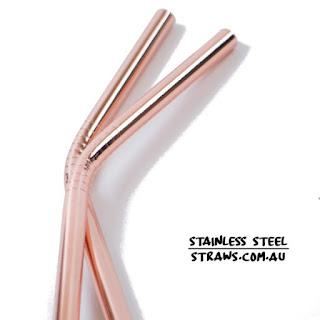 two rose gold stainless steel straws bent