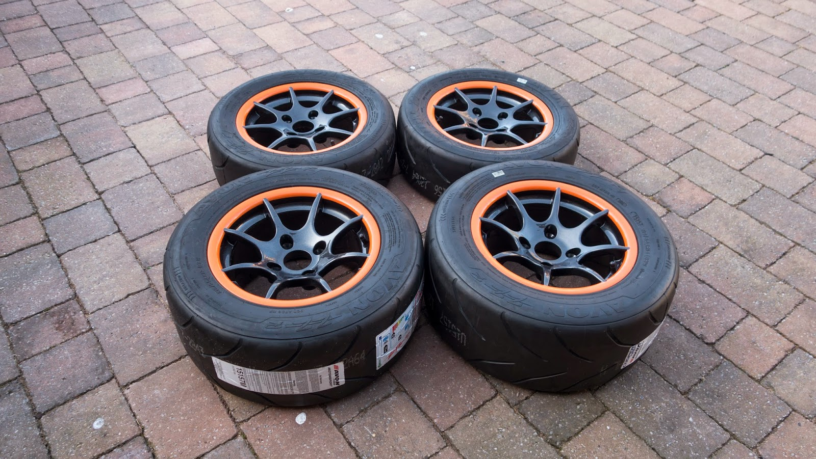 Caterham 8 spoke alloy wheels with orange rim fitted with AVON ZZR tyres