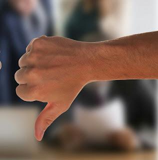Thumb down sign