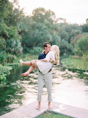 engagement photos picking up bride