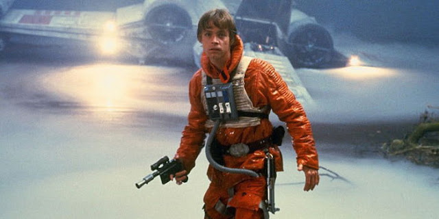 Luke Skywalker dressed as an X wing pilot on Dagobah